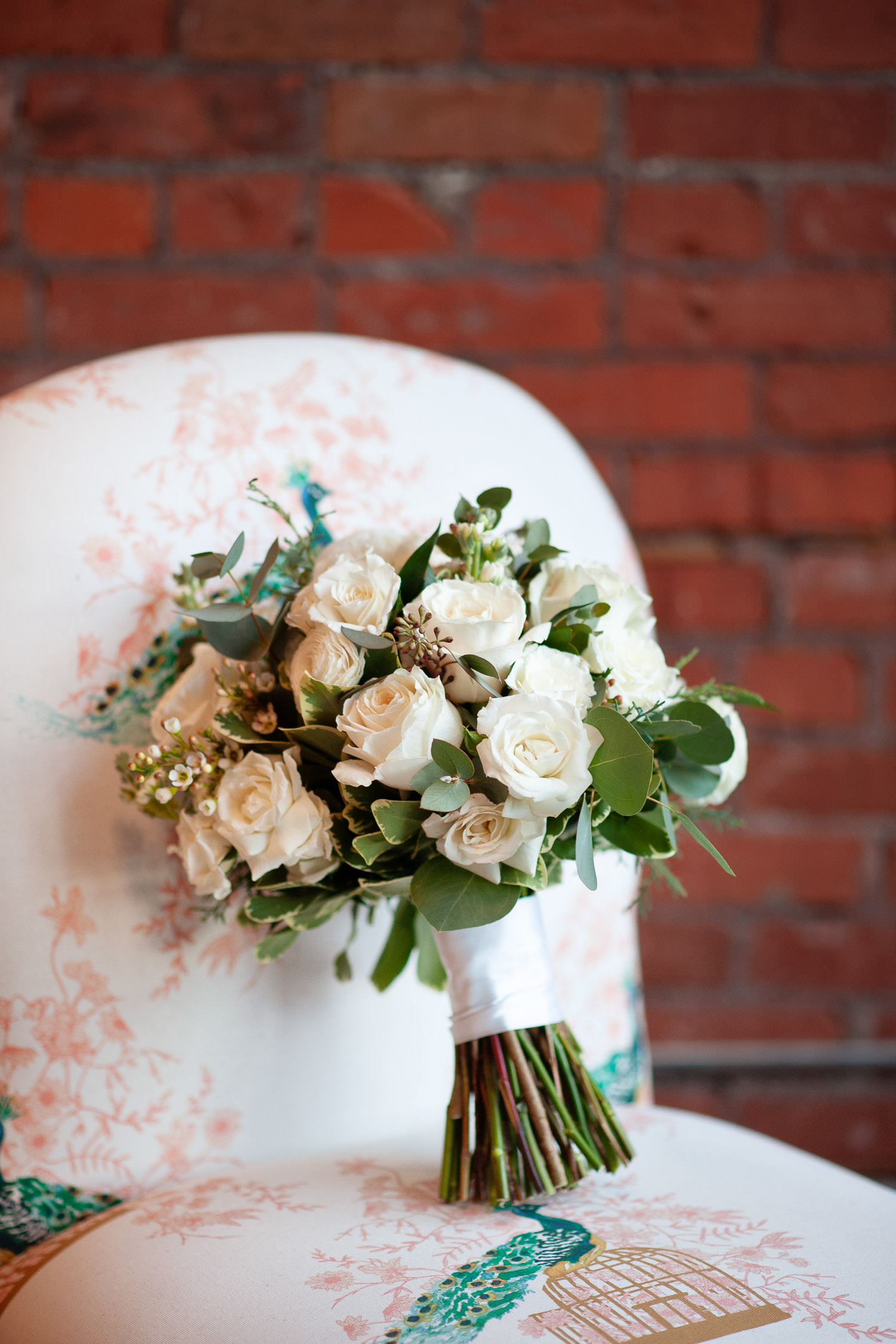 The bride's bouquet on a chair at Venue 308 captured by Tara Whittaker Photography
