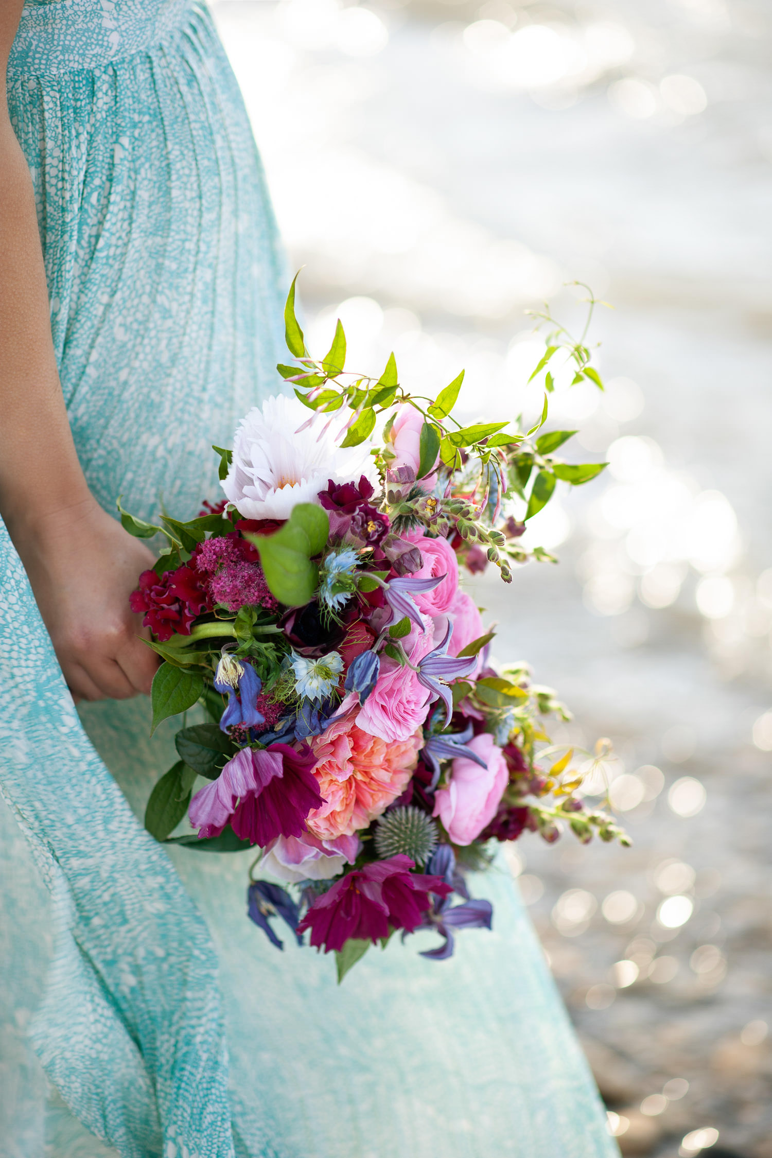 bride holds a pink bouquet from Flowers by Janie captured by Tara Whittaker Photography