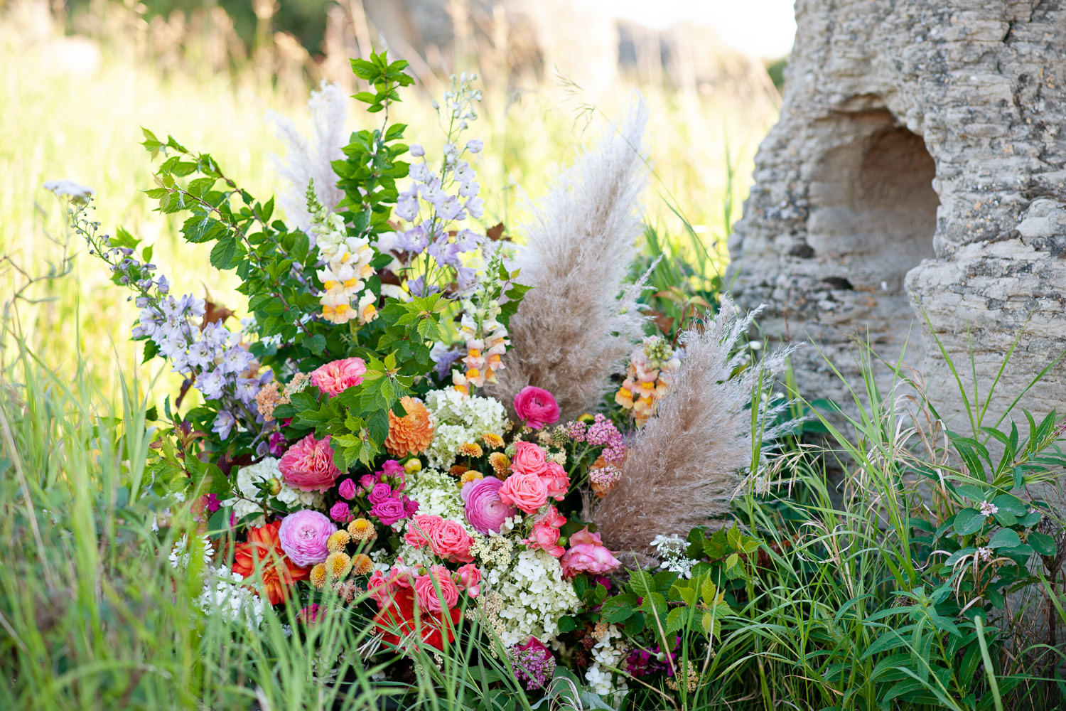 Floral arrangement at the base of a sandstone formation captured by Tara Whittaker Photography