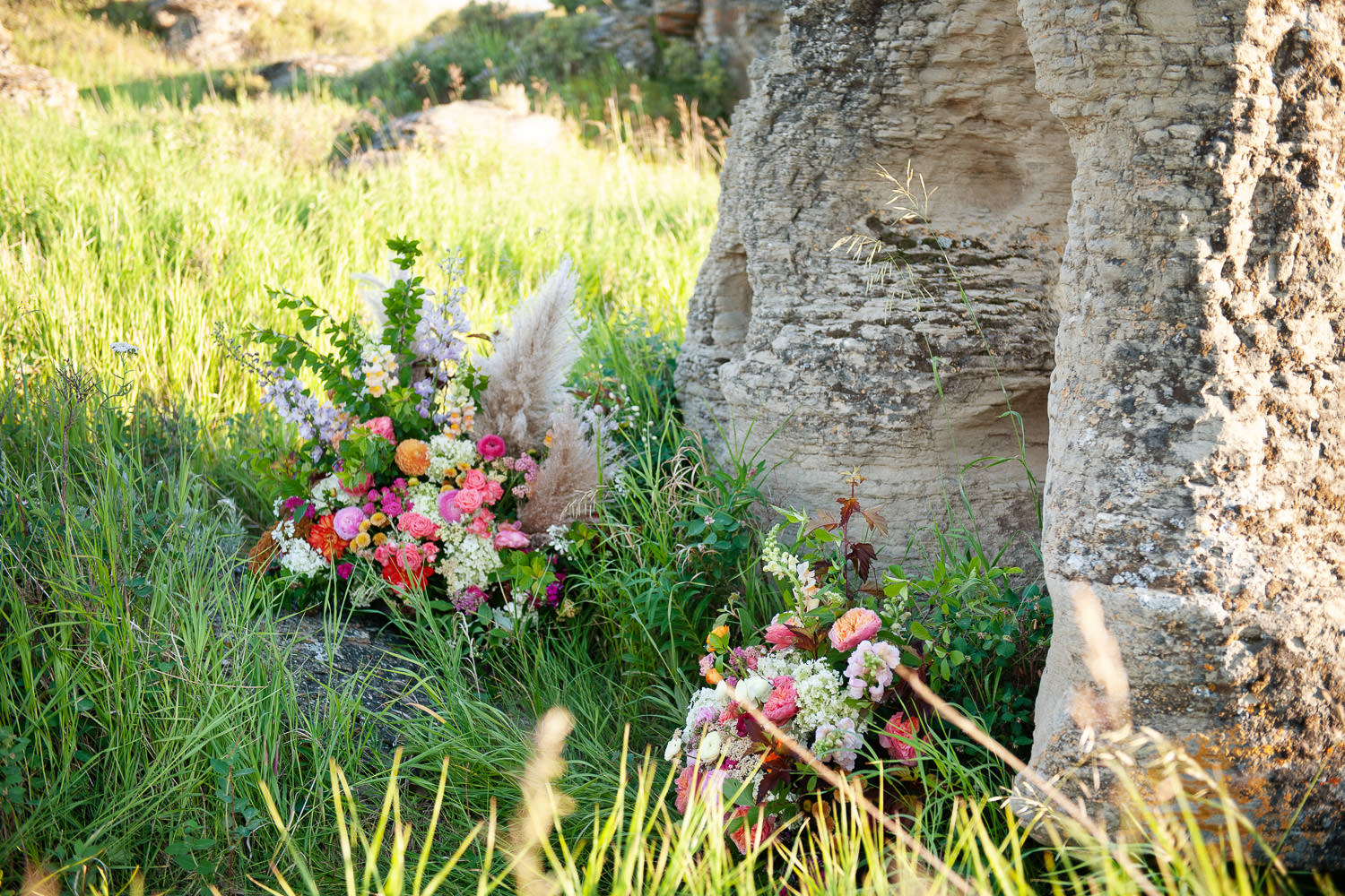 Flower arrangements at a ceremony site captured by Tara Whittaker Photography