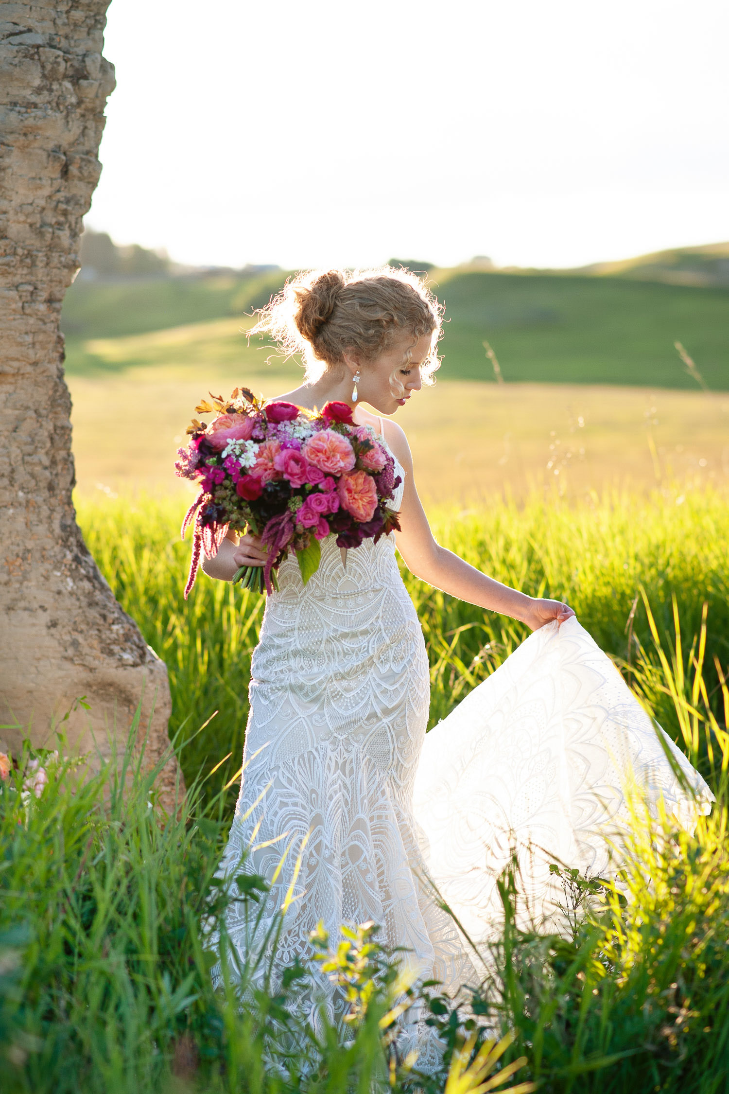 bride carrying a pink bouquet from Flowers by Janie captured by Tara Whittaker Photography