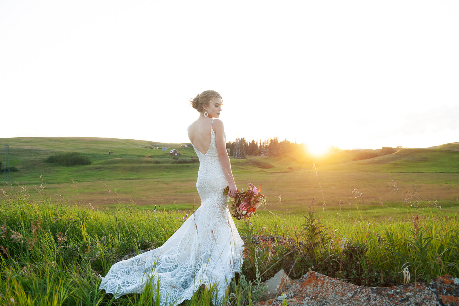 bride at sunset wearing lace gown by Lis Simon captured by Tara Whittaker Photography
