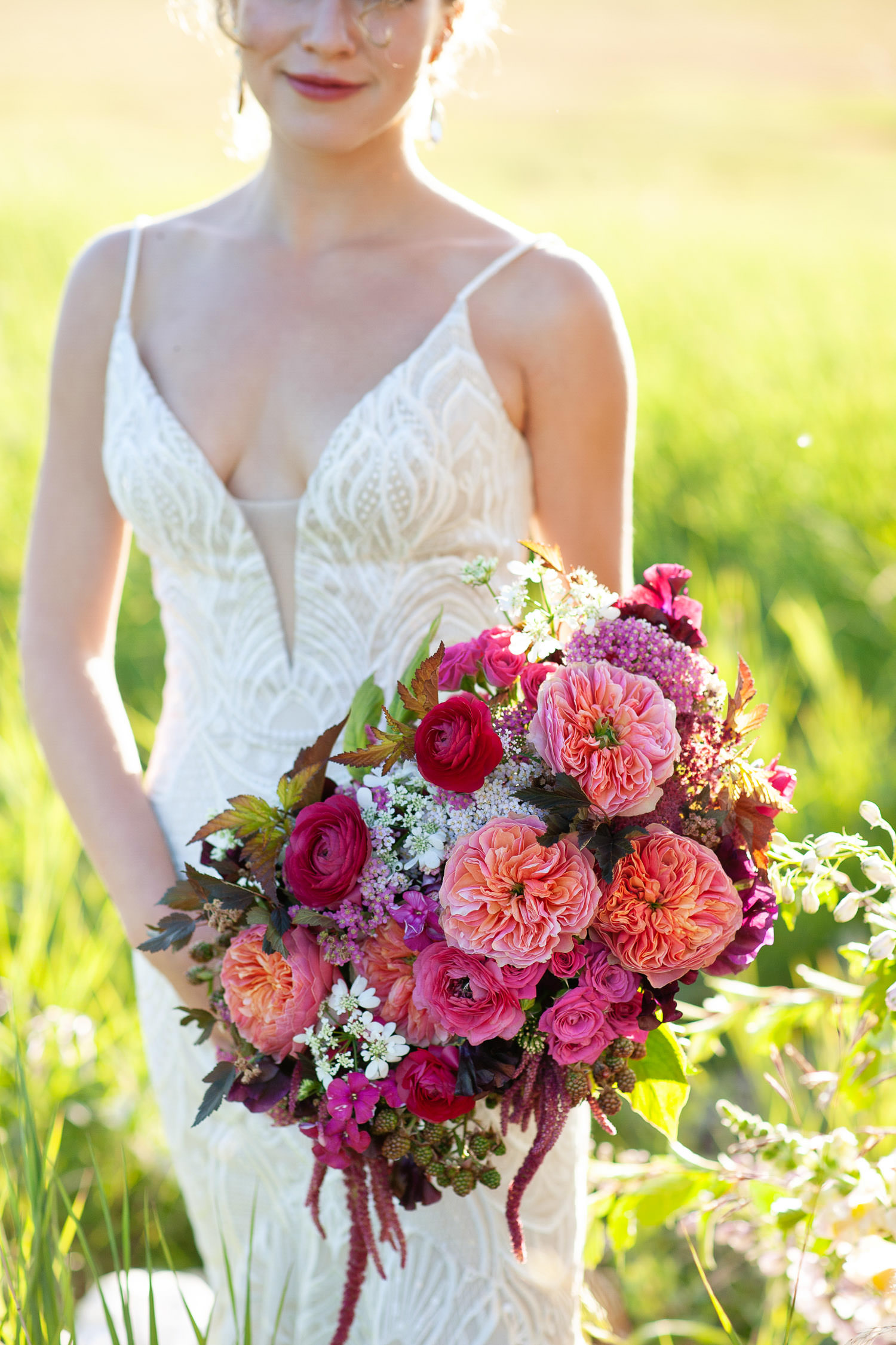 bride carries a rich pink bouquet from Flowers by Janie captured by Tara Whittaker Photography