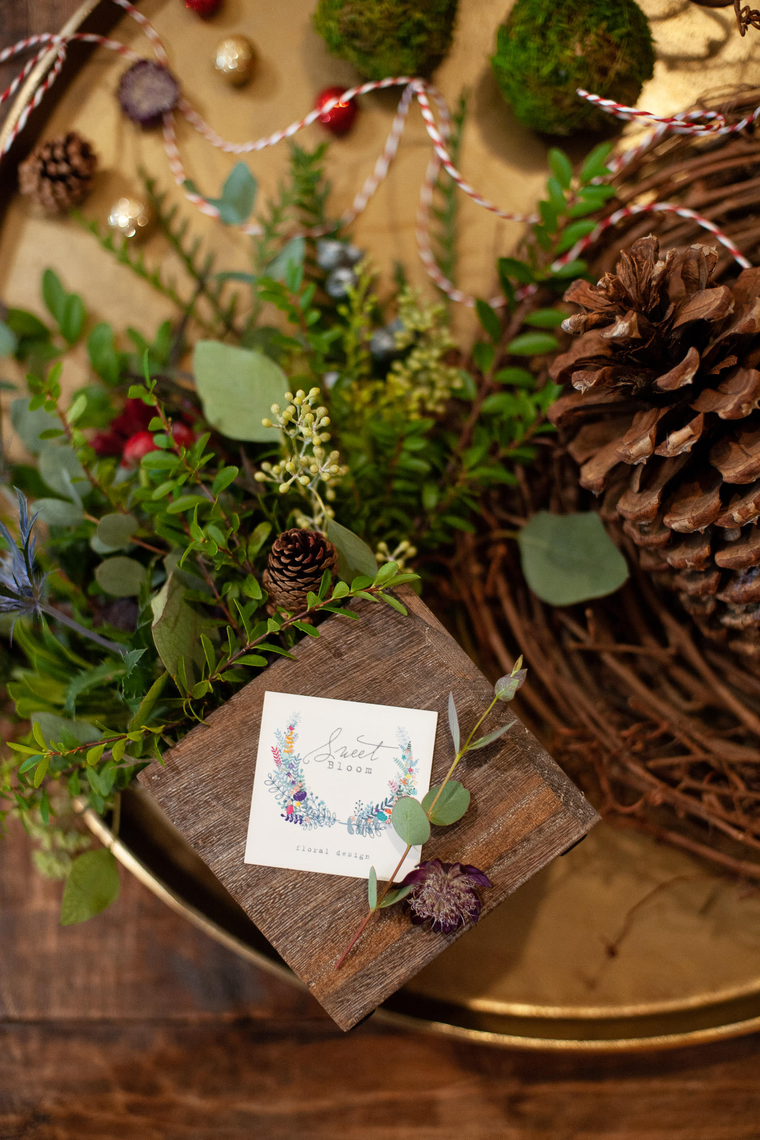 Each holiday mini session includes a festive bloom box from Sweet Bloom Floral Design